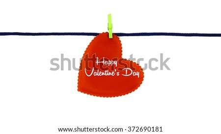 Single red love shape with text HAPPY VALENTINE'S DAY clipped on blue rope isolated on white background - stock photo
