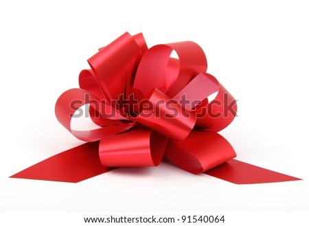 Single red ribbon plastic gift bow isolated on white background. - stock photo