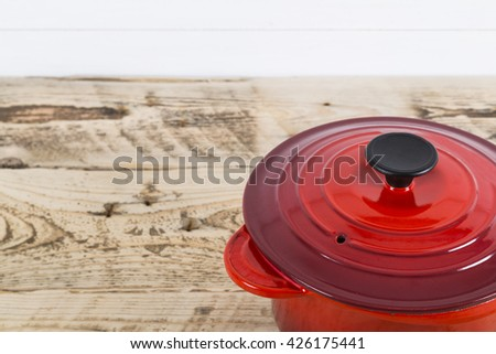 Single red saucepan - stock photo