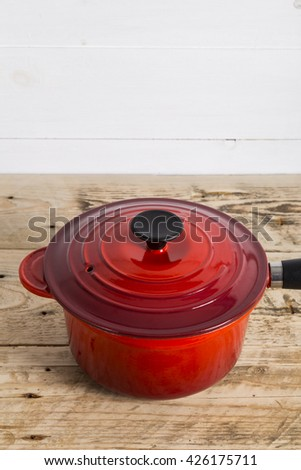 Single red saucepan and lid - stock photo