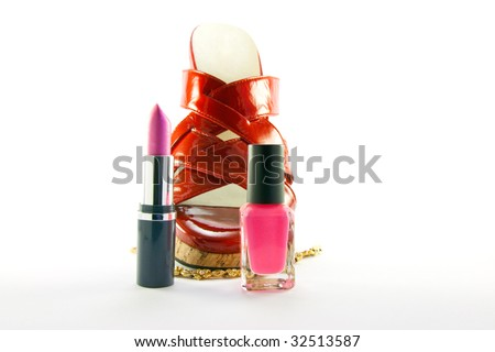 Single red shoe with lipstick, nail polish and gold bracelet with clipping path on a white background - stock photo