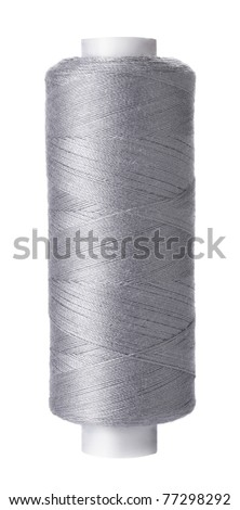 Single reel of gray thread on white background - stock photo