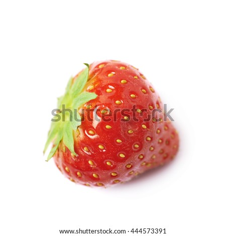 Single ripe red strawberry isolated over the white background
