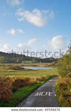 Single road on the Isle of Seil - stock photo