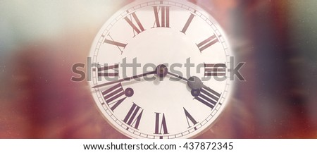 Single round antique wind up clock face with Roman numerals and red blurry edges - stock photo