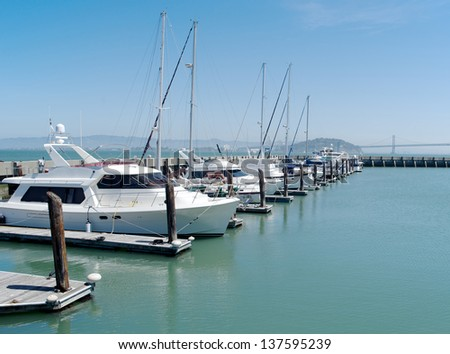 Single row of boats docked in San Francisco - stock photo