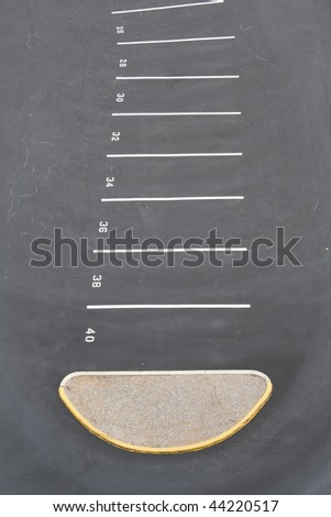 single row of numbered parking spaces - stock photo
