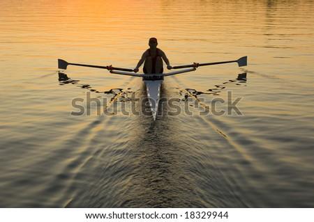 single rower at sunrise - stock photo