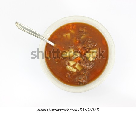 Single serving of beef pot roast stew in an old bowl with a silver spoon - stock photo