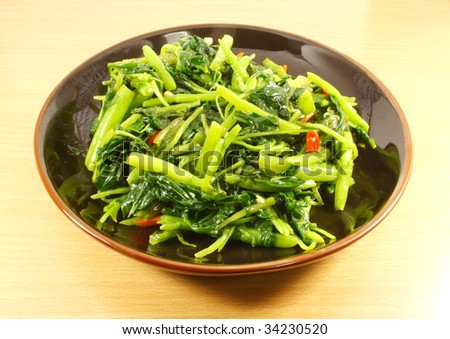 Single Serving of Chinese Vegetables on a Black Plate