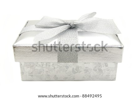 Single silver gift box with bow over white - stock photo