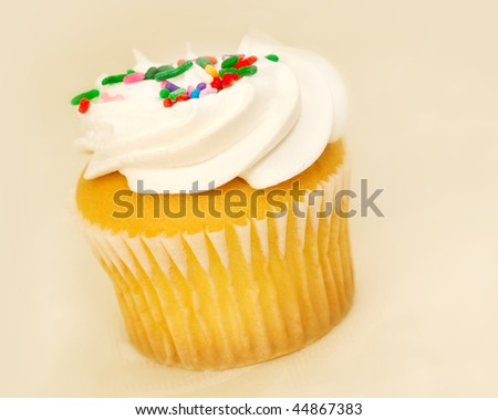 Single simple cupcake with candy on top