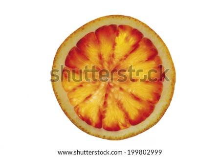 Single slice of blood orange, close-up - stock photo