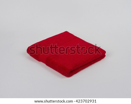 Single Small Towel folded on gray background
