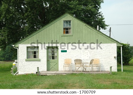 Single story concrete house in the country. - stock photo
