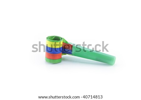 Single striped party blower on a reflective white background - stock photo