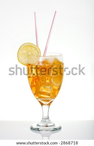 Single tall glass of iced tea full of ice cubes, slices of lemon and two straws over white background - stock photo
