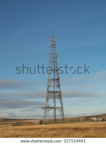 Single telecommunication tower taken on a winter morning. Mobile broadcasting transmitter on hilltop location