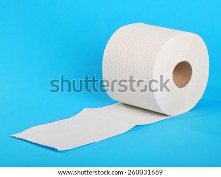 Single toilet paper on blue - stock photo