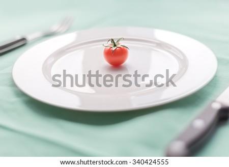 single tomato - stock photo