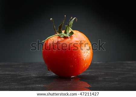 single tomato water droplets - stock photo