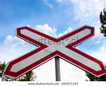 Single track railway crossing sign in Ukraine. Close up. - stock photo