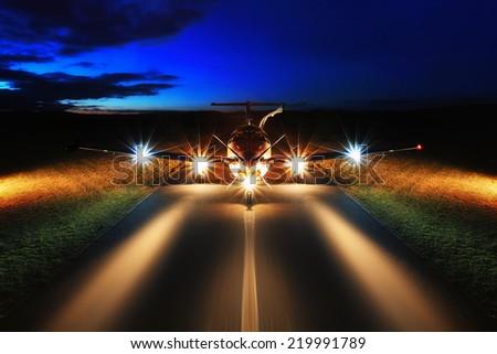 Single turboprop aircraft on the groun, night - stock photo