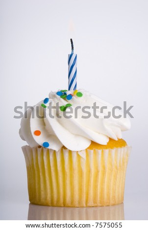 Single Vanilla Cupcake with Blue Candle - stock photo