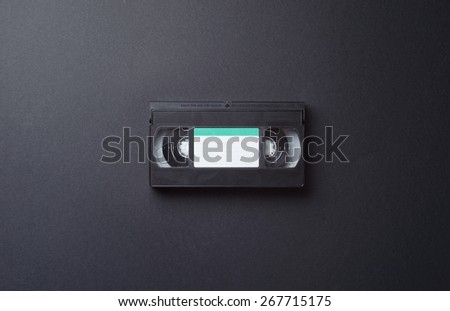 Single VHS Cassette in the center of the image with copy space for text or other design - stock photo
