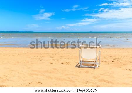 single white beach chair on the beach, pattaya, thailand - stock photo