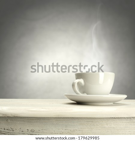 single white cup of coffee and white desk in kitchen  - stock photo
