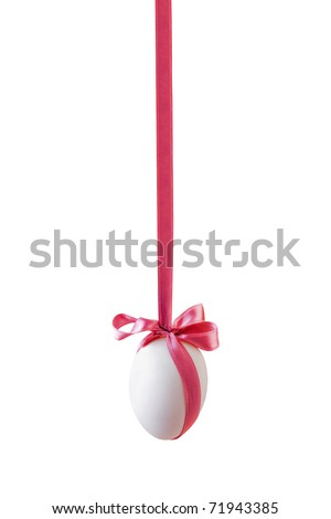 Single white easter egg with bow hanged on the pink satin ribbon isolated on white background (clipping path included) - stock photo
