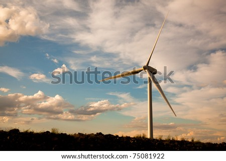 single wind turbine at sunset - stock photo
