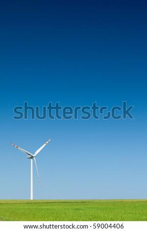 single wind turbine, cloudless sky in background - stock photo