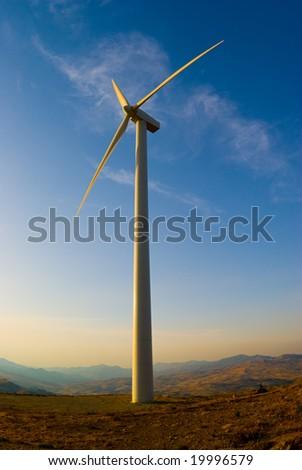 single wind turbine in sunset - stock photo