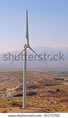 single wind turbine in the desert - stock photo