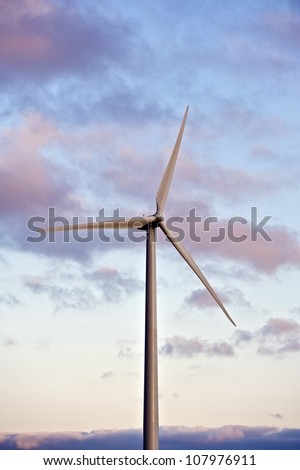Single Wind Turbine on Afternoon Near Sunset Sky. Green Energy Technologies.