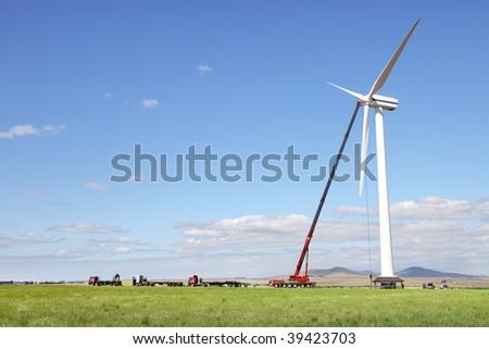 Single wind turbine under construction - stock photo