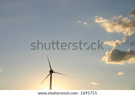 Single windmill against a sunset