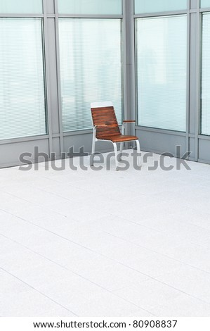 Single wooden chair in a bright empty room. - stock photo
