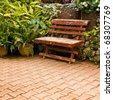 single wooden chair in the small garden - stock photo