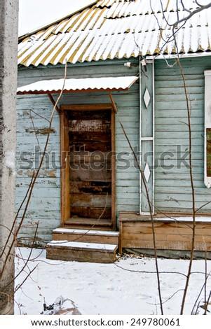 Single Wooden Door in Old Slum Hut Wall  in Astrakhan, Russia - stock photo