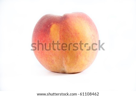 Single yellow and orange fuzzy peach on a white isolated background - stock photo