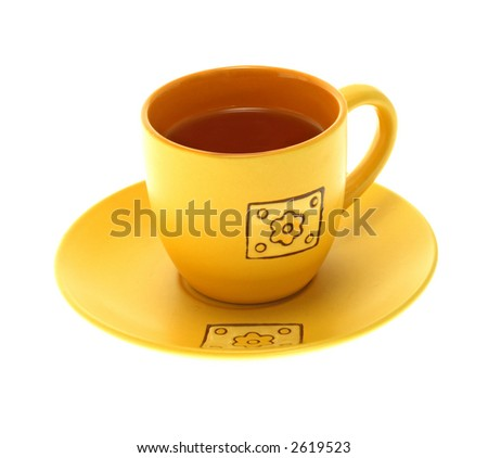 Single yellow tea cup on a white background - stock photo