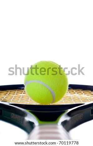 Single yellow tennis ball looking down the brown leather handle of a tennis racket