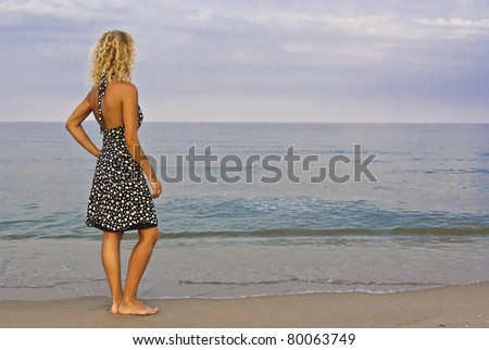 Single young women standing on coast