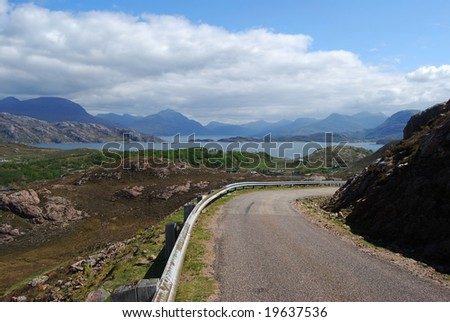 singletrack road in northern Scotland surrounded by beautiful scenery