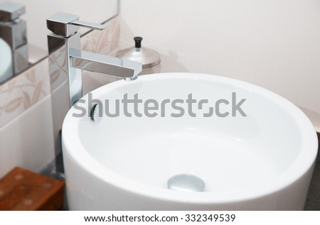 Sink and water tap. Horizontal close-up photo - stock photo