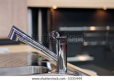 Sink appliance , faucet , close up - stock photo