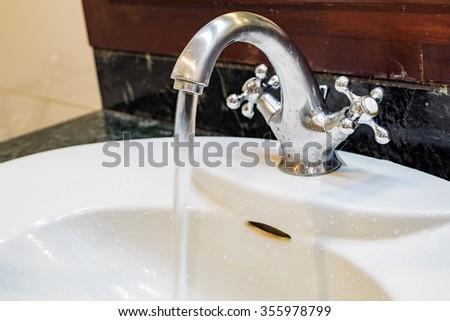 Sink basin flowing - stock photo